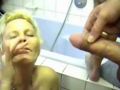 Milf receives him off in her bathroom
