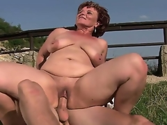 Aged bbw Manyika with bald fur pie bonking with young boyfriend at the open air