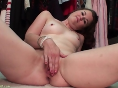 Milf strips stripped in her closet to model little tits