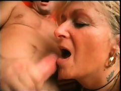 Horny blonde older slut spreads her legs and gets her wet