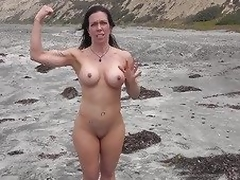 Sexy MILF shows us her goodies on the beach
