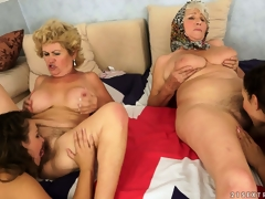 An fuckfest of pussy with old and youthful lesbians munching the rug